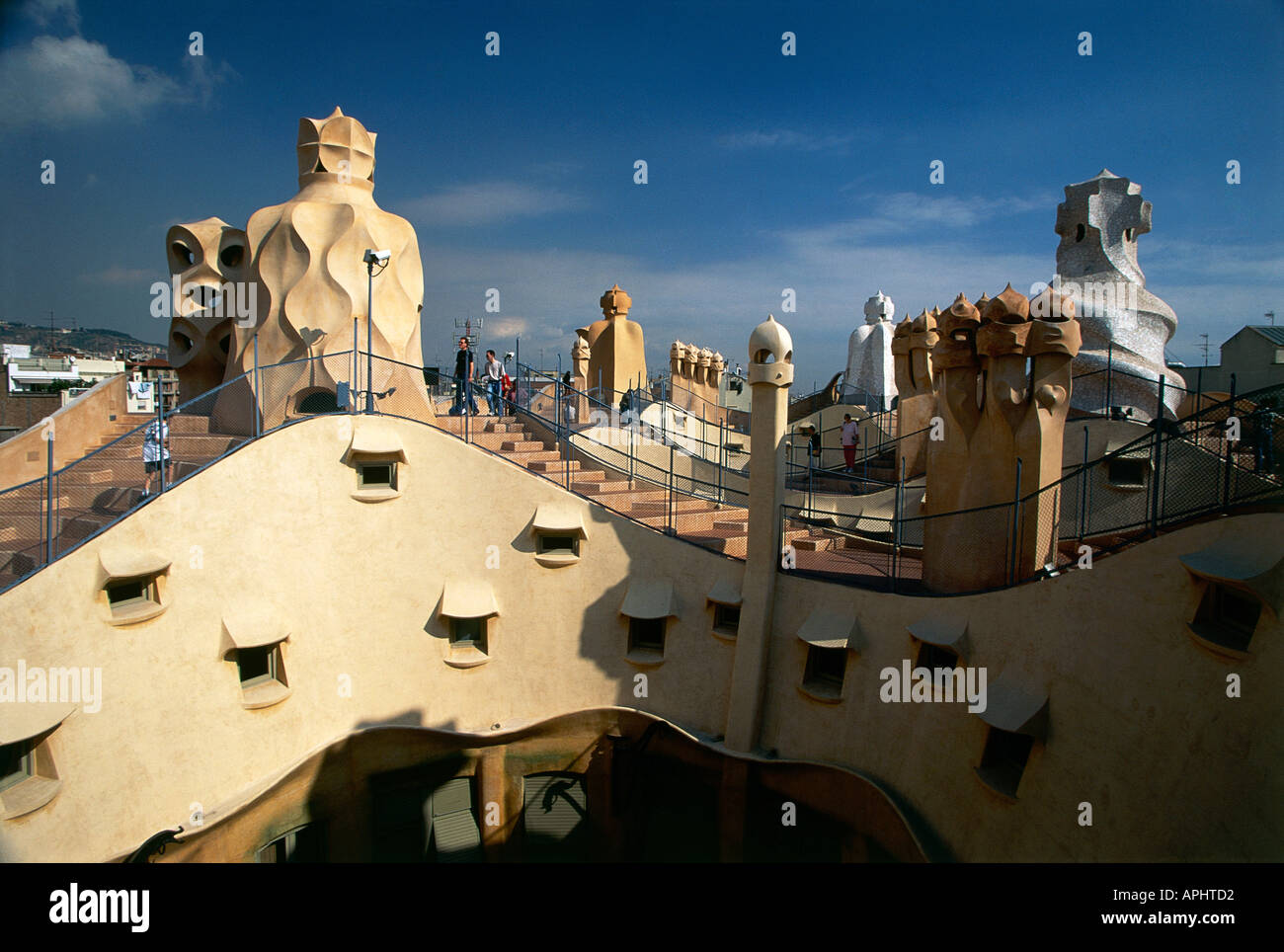 Chimneys on roof of Casa Mila or La Pedrera apartment building that was designed by Antoni Gaudi 1852 1926 Barcelona Spain - Stock Image