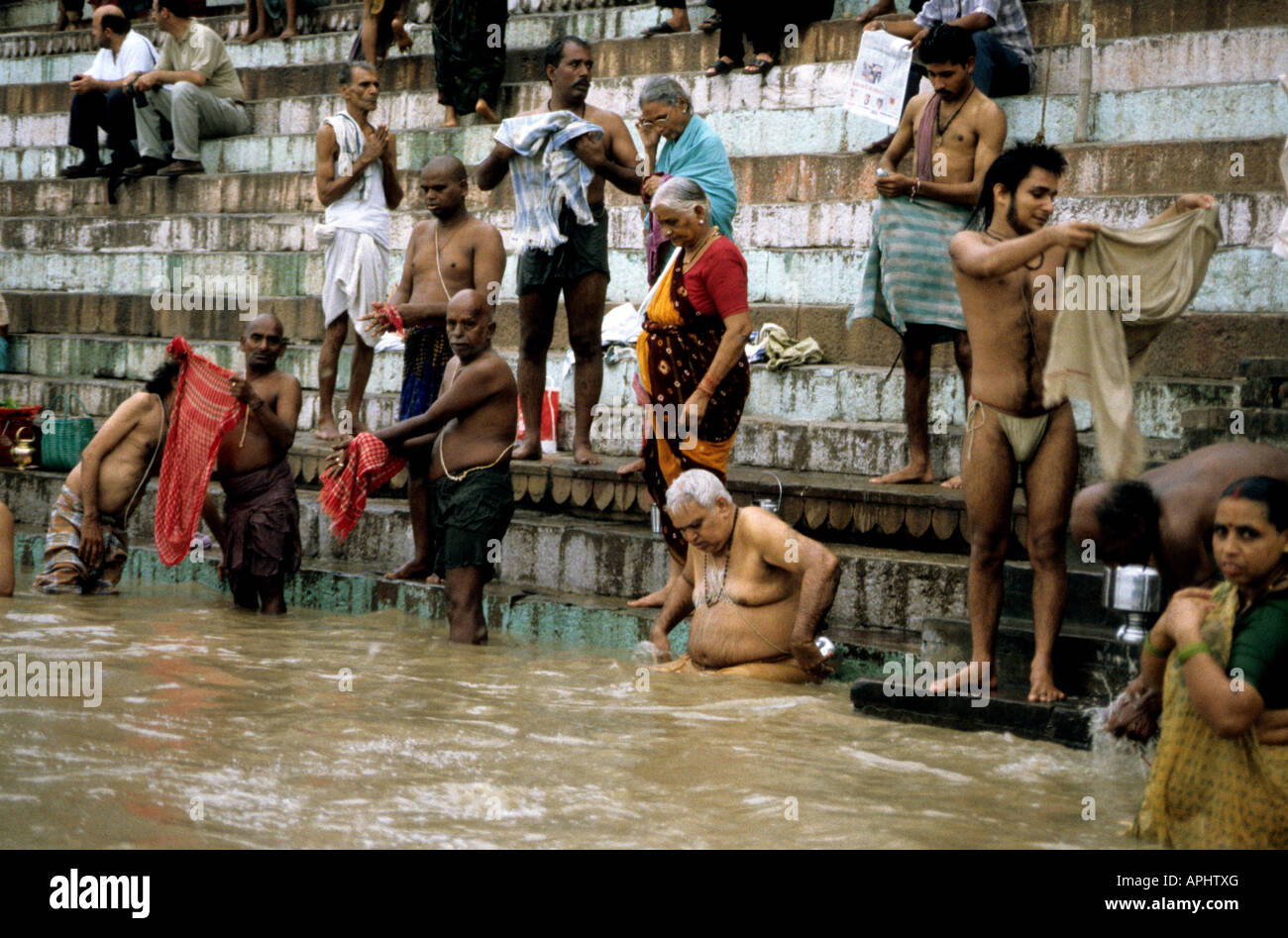 c95b32bdb01 Indian men and women bath in the holy Ganges river in Varanasi Stock ...
