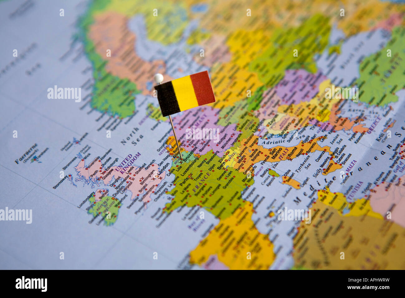 flag pin placed on world map in the capital of belgium brussels