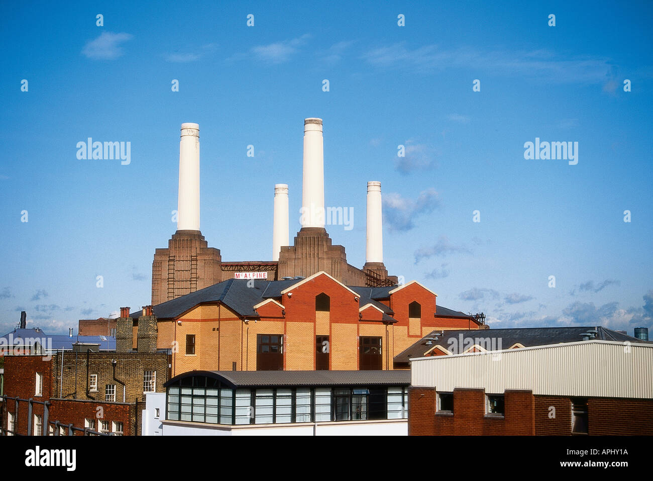 White chimneys dominate the sky line above Battersea Power Station London England designed by Sir Giles Gilbert Scott - Stock Image