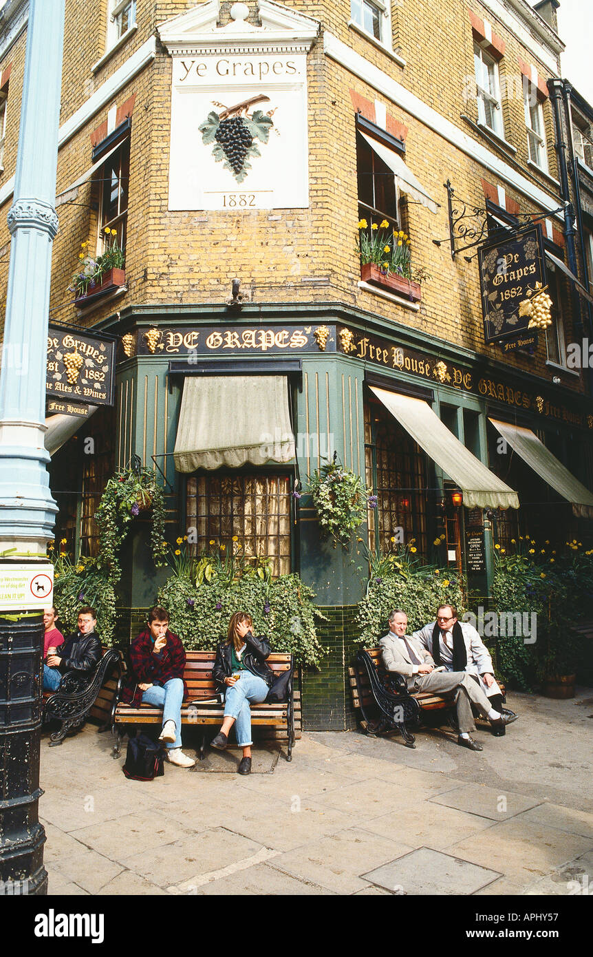 Ye Grapes pub in Shepherds Market Mayfair London England with people sitting outside - Stock Image