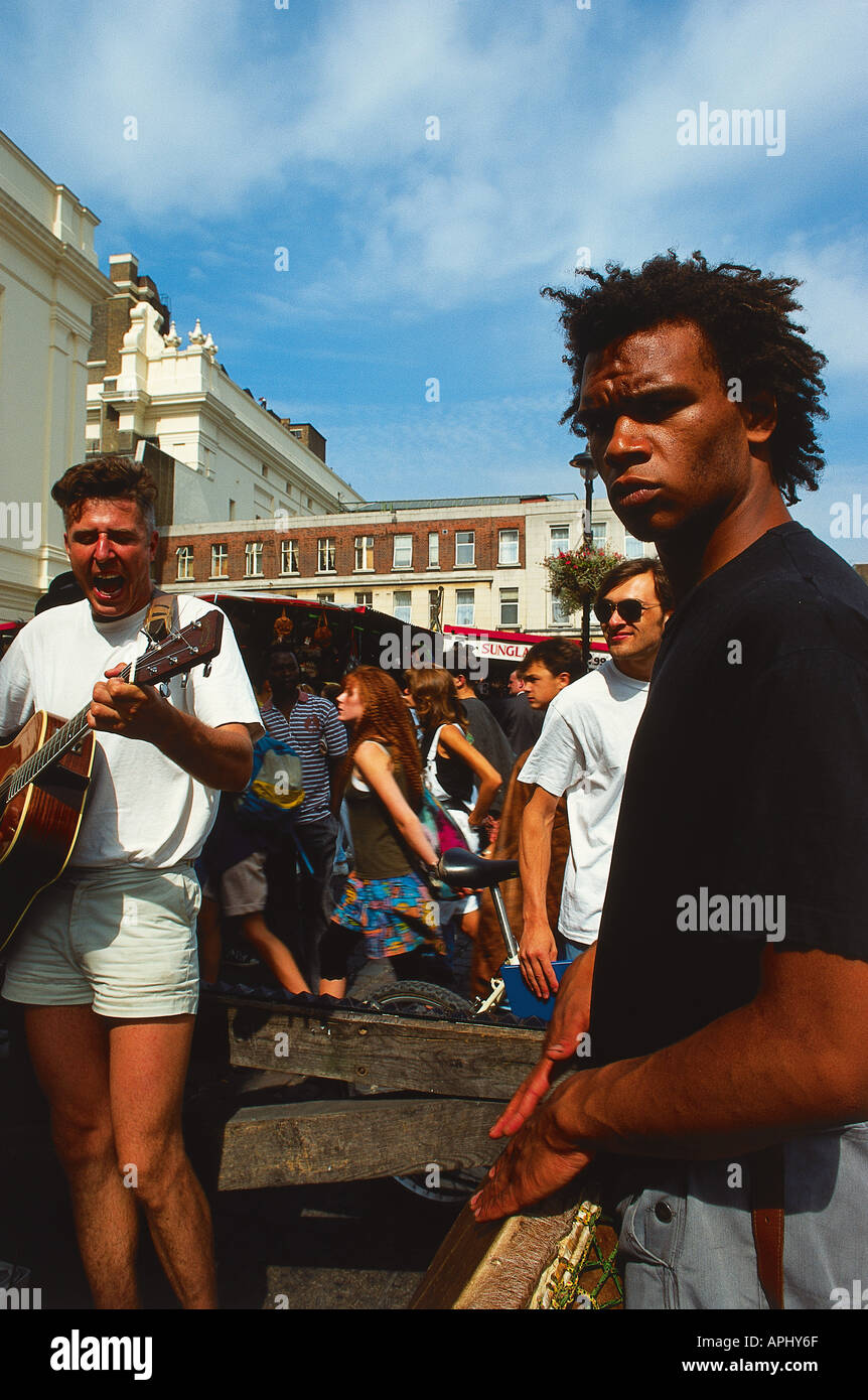 An Afro Caribbean band member and his colleague on the guitar in London England - Stock Image