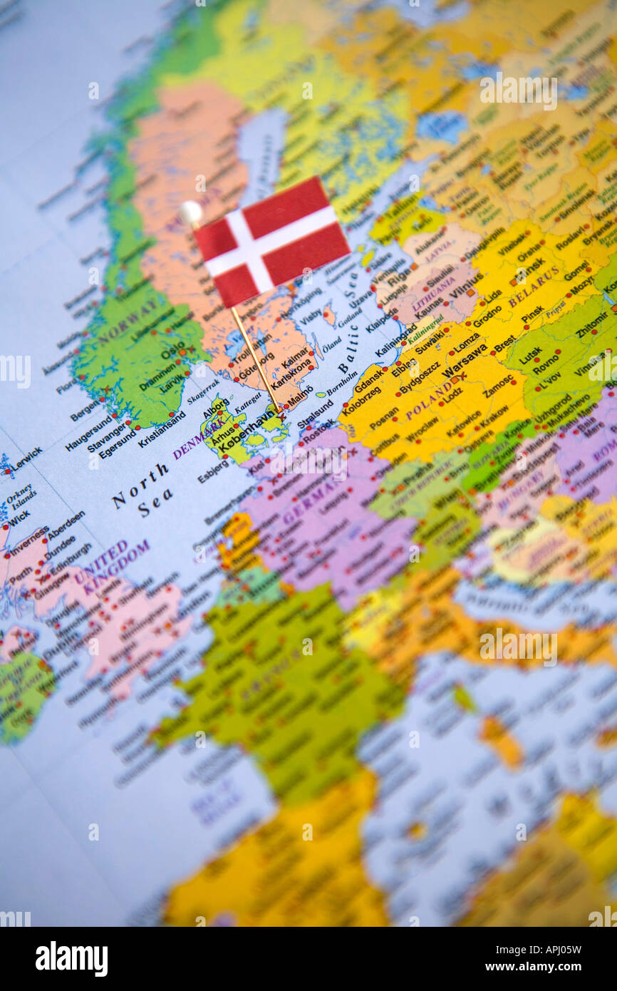 flag pin placed on world map in the capital of denmark copenhagen