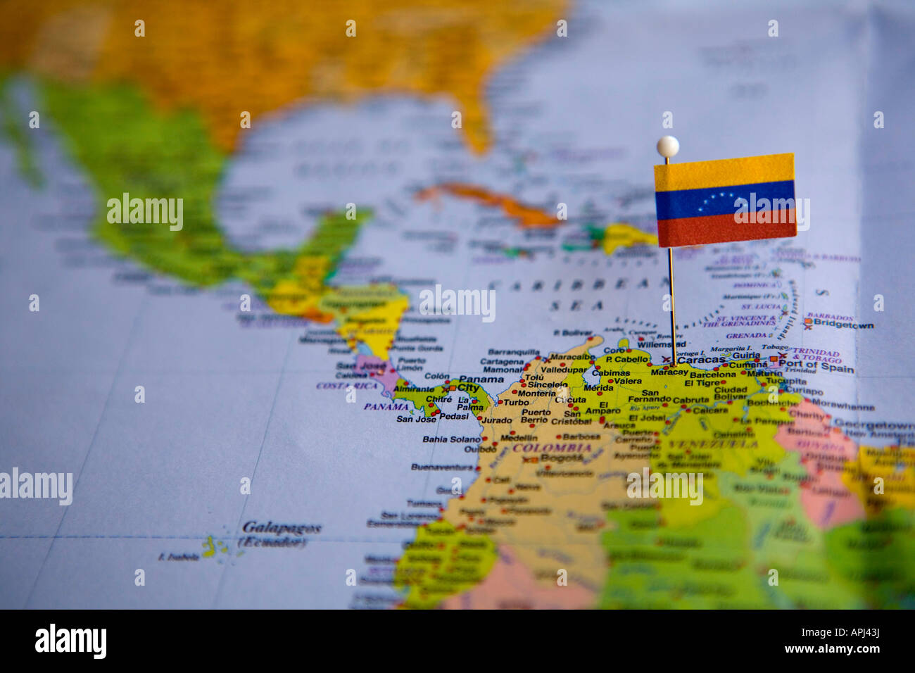 Flag Pin Placed on World Map in the Capital of Venezuela Caracus
