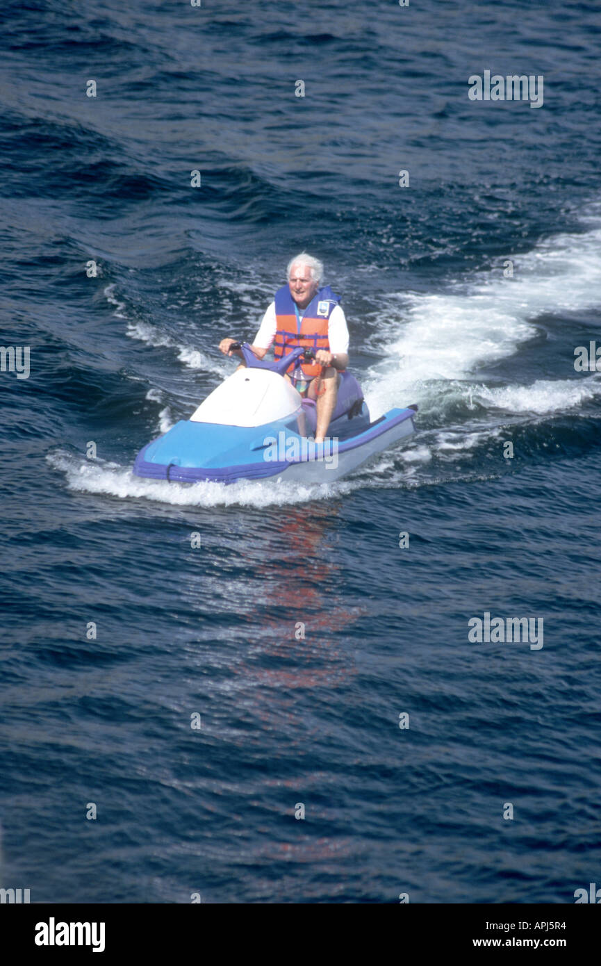Never too old!Watersports are not only for the young! Older man enjoying the sport on a Jetski - Stock Image