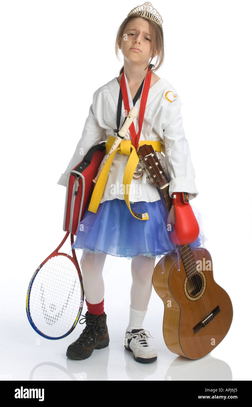 studio concept image of ten years old girl overwhelmed by too many extra curricular activities - Stock Image