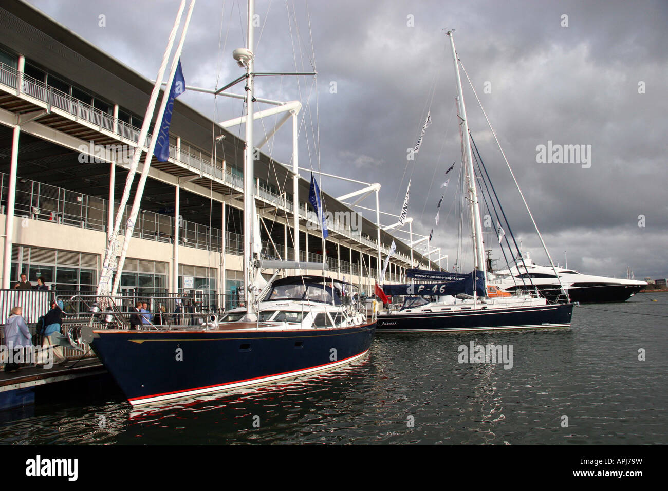 large blue saling yatch moored up at the quay for the london boat show - Stock Image