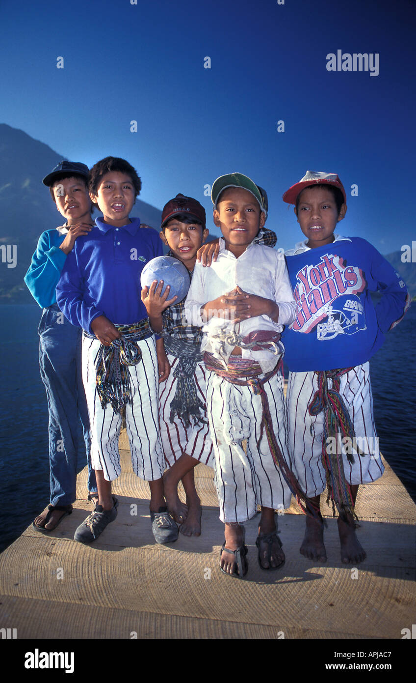 Group of Maya boys from Santiago Atitlan pose for a photo on one of the wooden jetties Santiago Atitlan - Stock Image