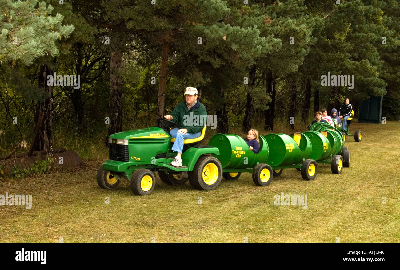 Kids Ride On Lawn Tractor With Trailers Stock Photo