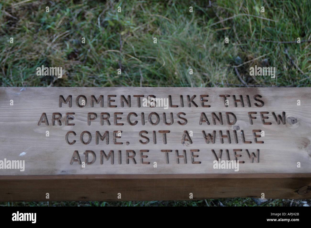 Inscription on seat in woodland walk - Stock Image