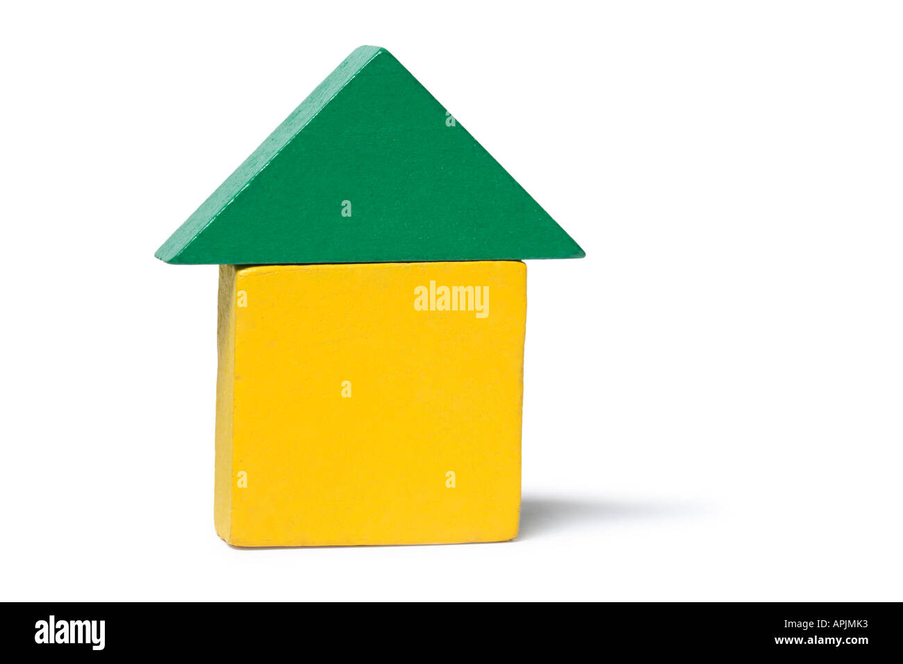 Blocks stacked up in the shape of a house. - Stock Image