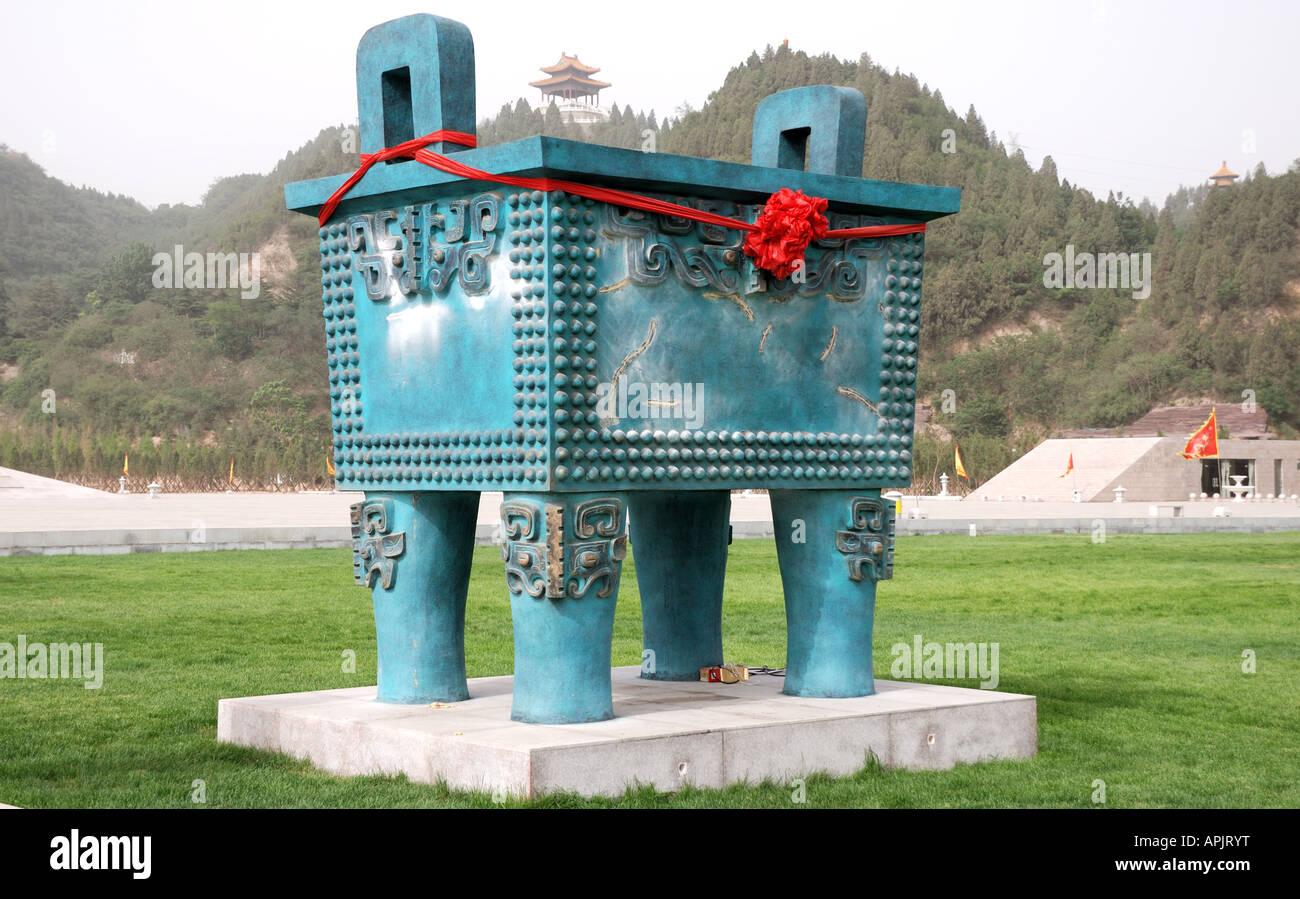 Bronze four legged rectangular ding or cauldron at Yellow River Scenic Area Henan Province Zhengzhou China - Stock Image