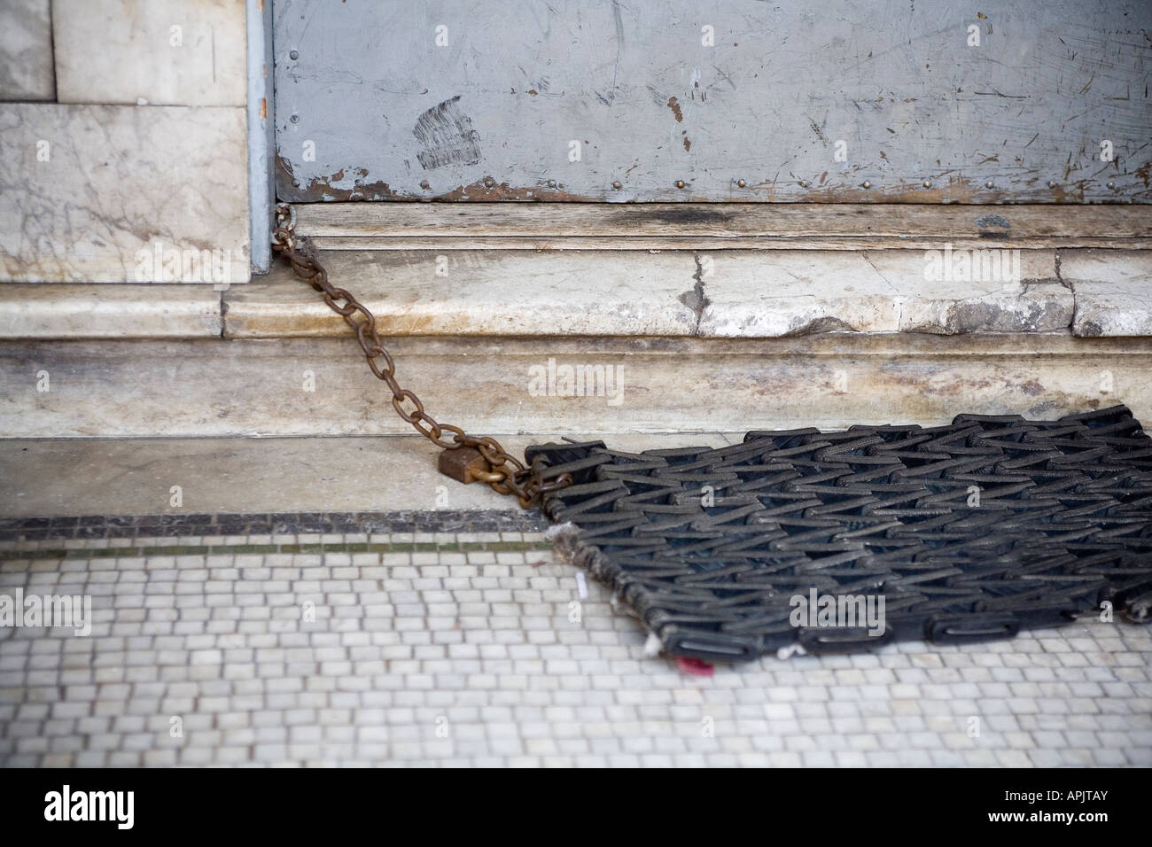door mat secured by lock and chain - Stock Image