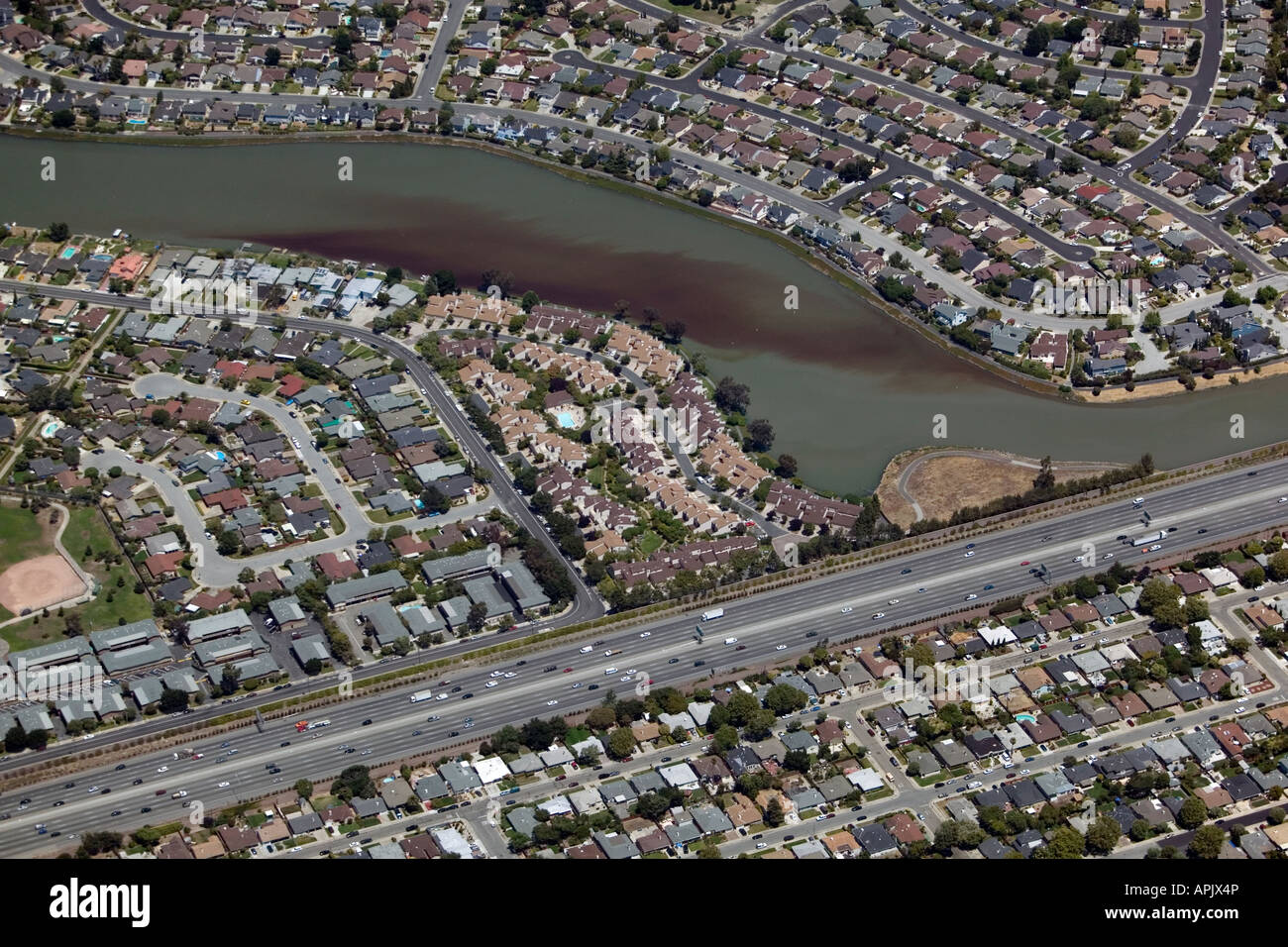 aerial view above water pollution Foster City California San Francisco bay at highway 101 - Stock Image