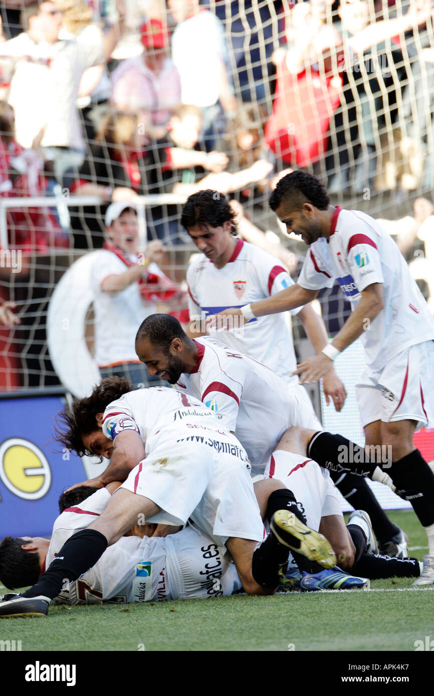 football players celebrating a goal - Stock Image