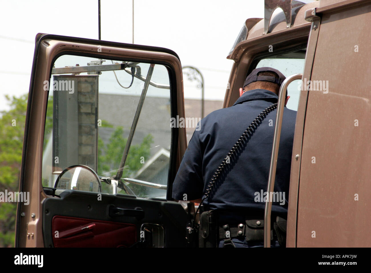 The police gathering information for a report on a traffic accident from the driver of the semi big rig trailer - Stock Image