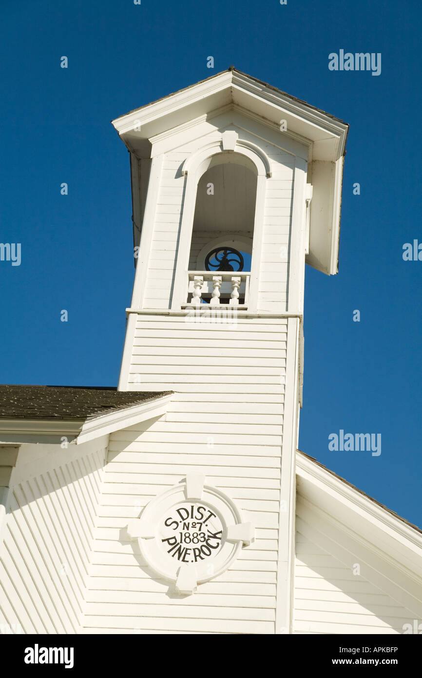 ILLINOIS Ogle County Bell in cupola of Chana two room schoolhouse museum registered historic building white wooden - Stock Image
