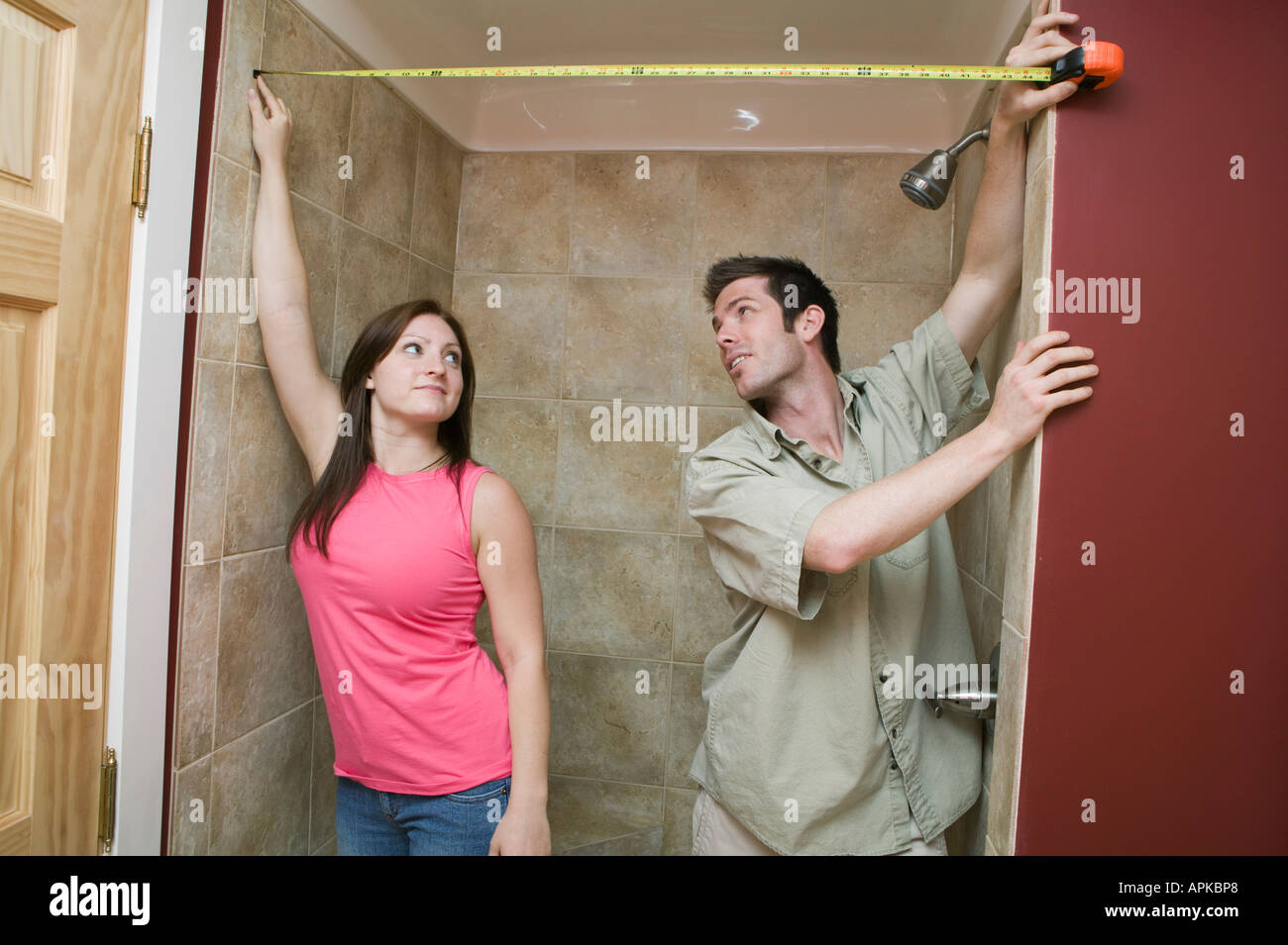 Couple Measuring For A Shower Curtain