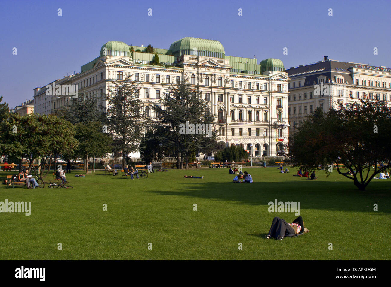 sunbathing people on the lawn of the Sigmund-Freud-Square, Austria, Vienna - Stock Image