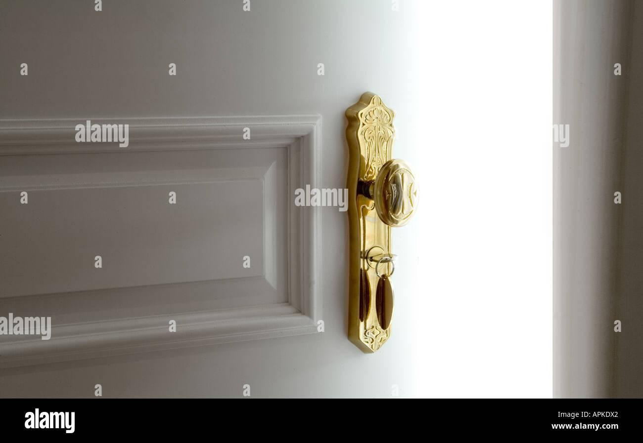 White Door With Fancy Gold Door Knob Slightly Open Bright White Room Light