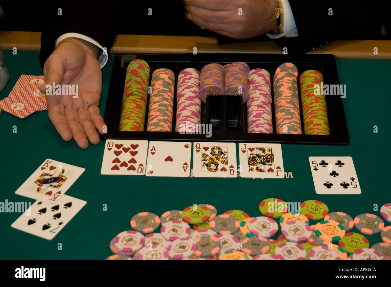 A poker dealer's hand with cards and chips In Las Vegas Nevada Caesars Palace and Casino - Stock Image