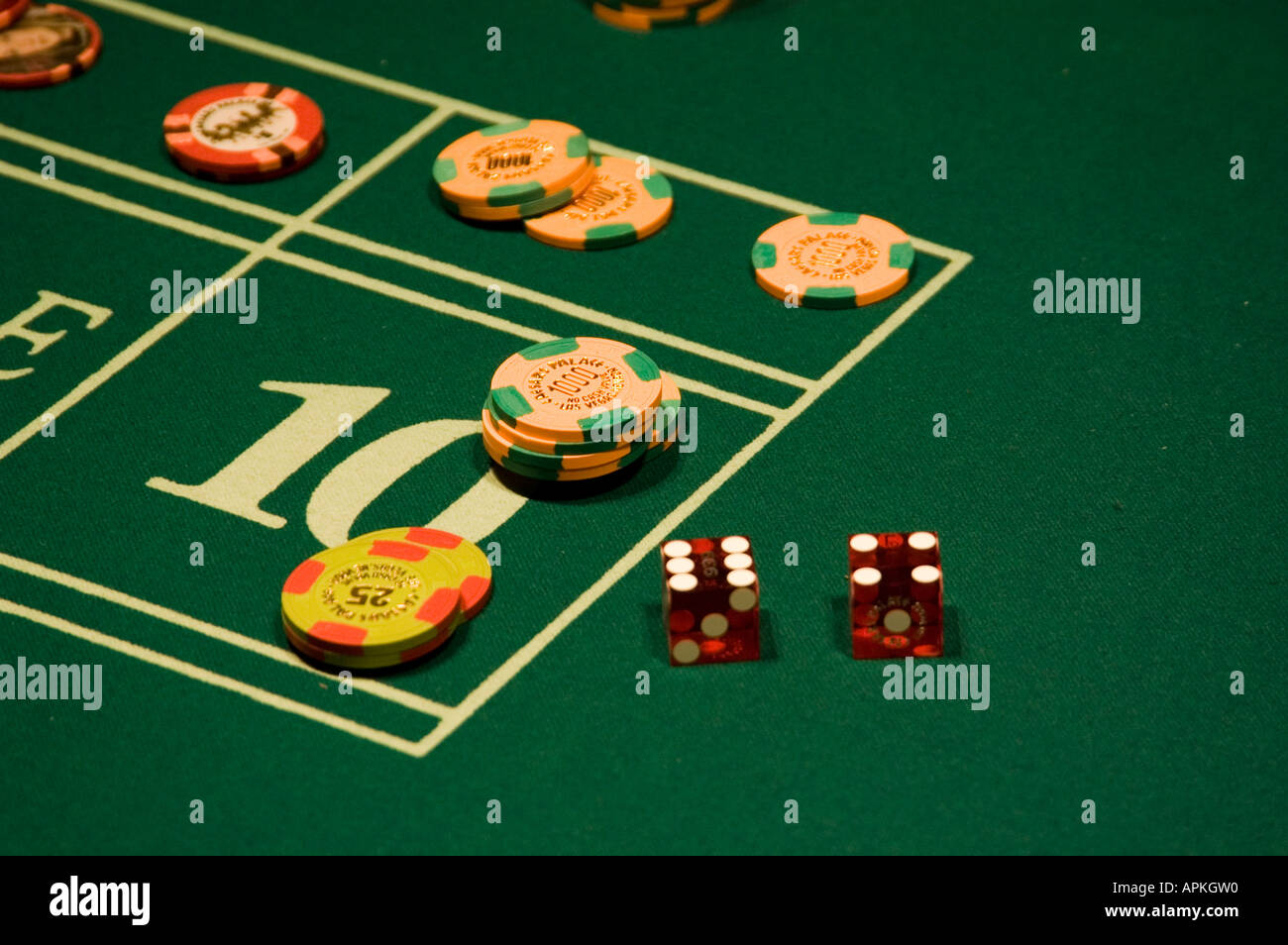 Dice and chips on a craps table in Las Vegas Nevada Caesars Palace and Casino Stock Photo