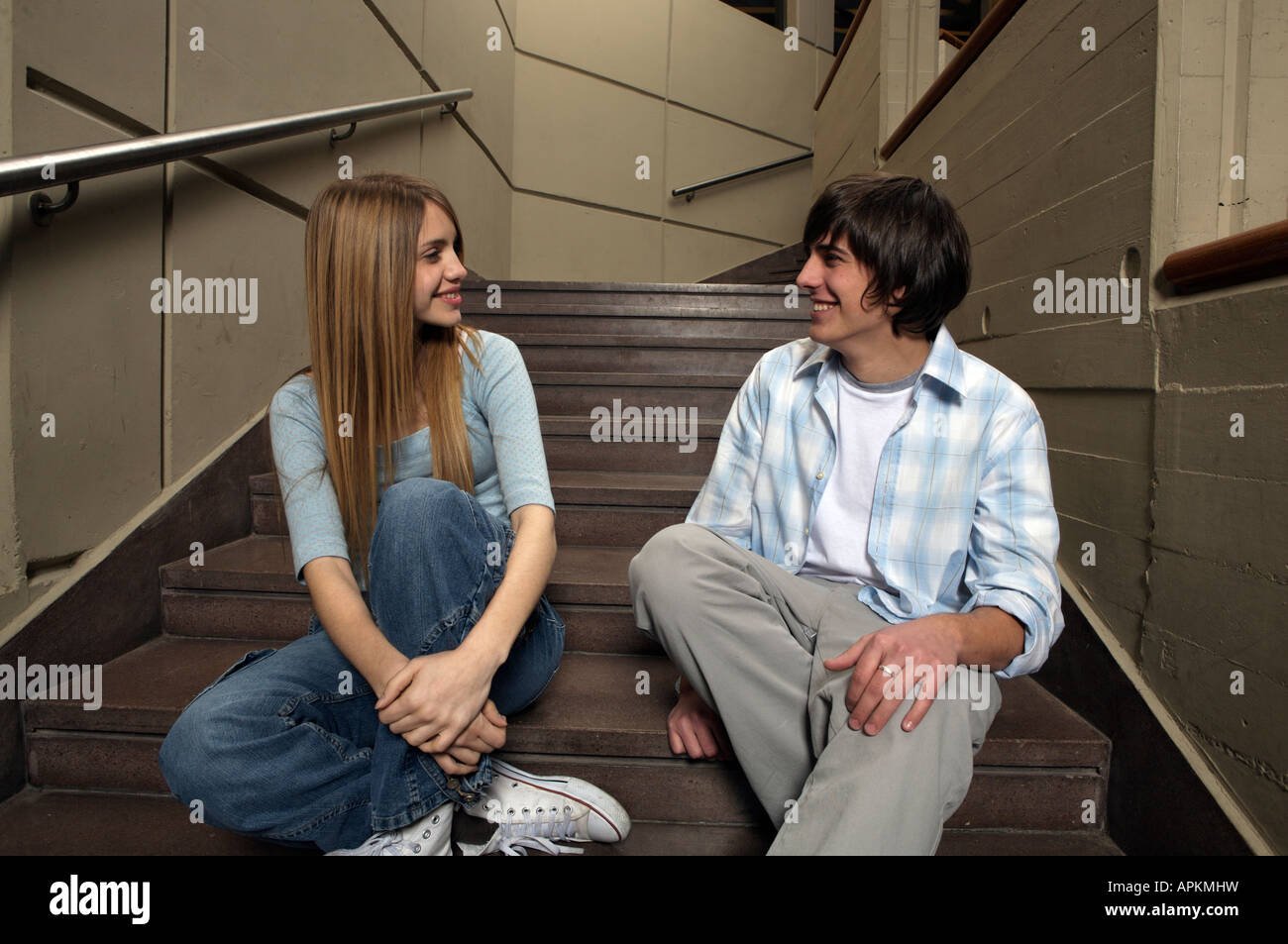 Students sitting on staircase - Stock Image