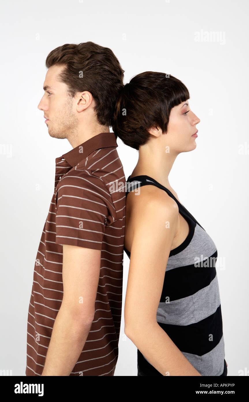 Couple Back To Back Stock Image