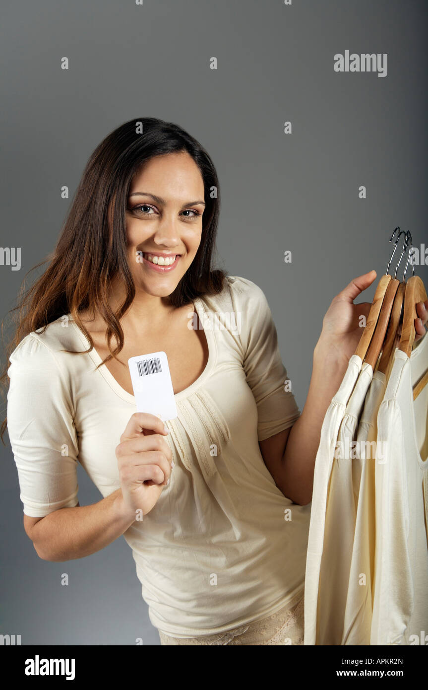 Woman showing clothe's price - Stock Image