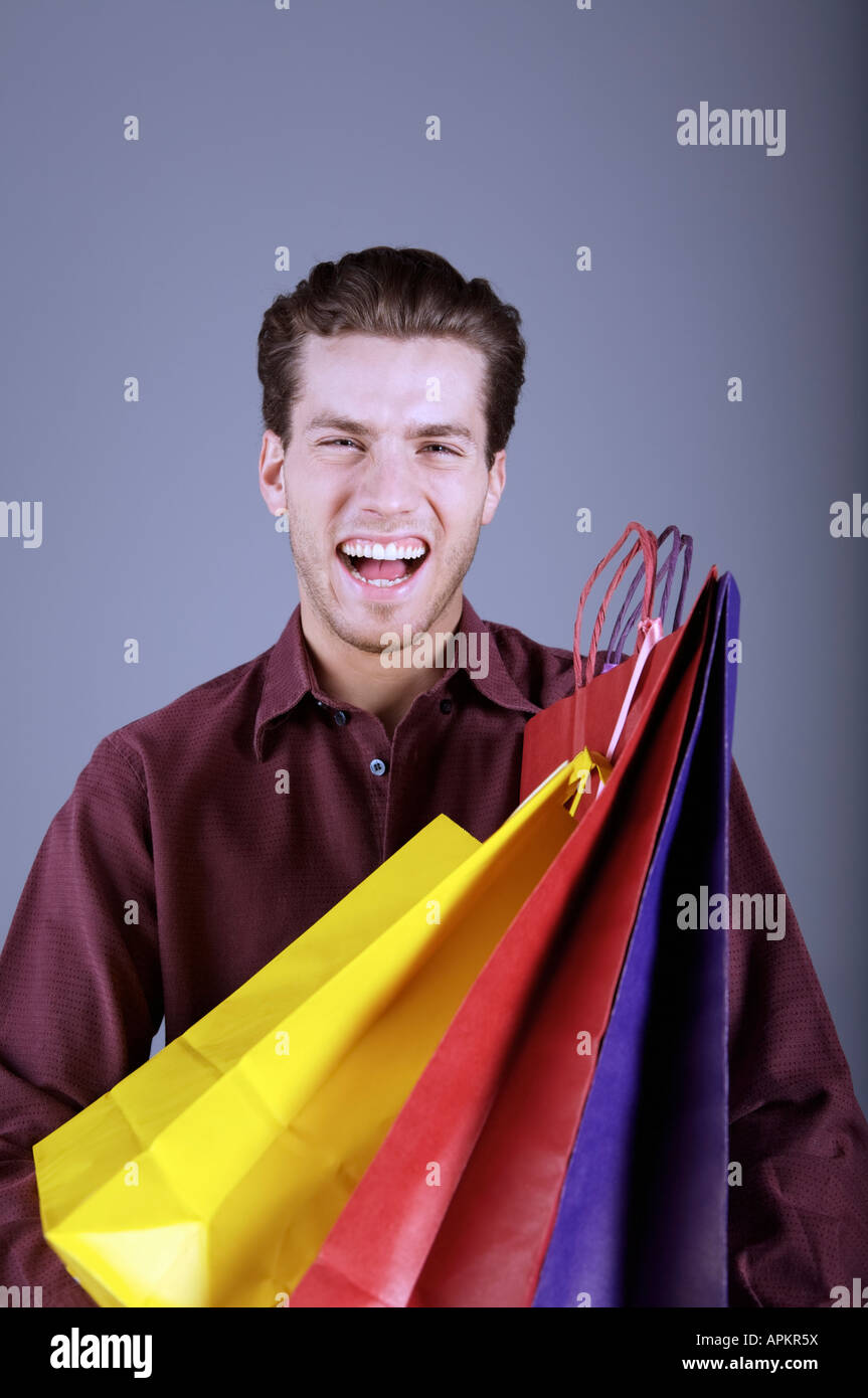 Young man with shopping bags - Stock Image