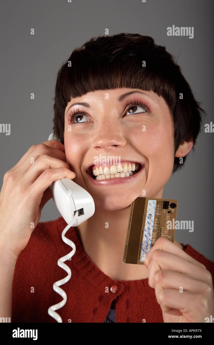 Woman shopping on the phone - Stock Image