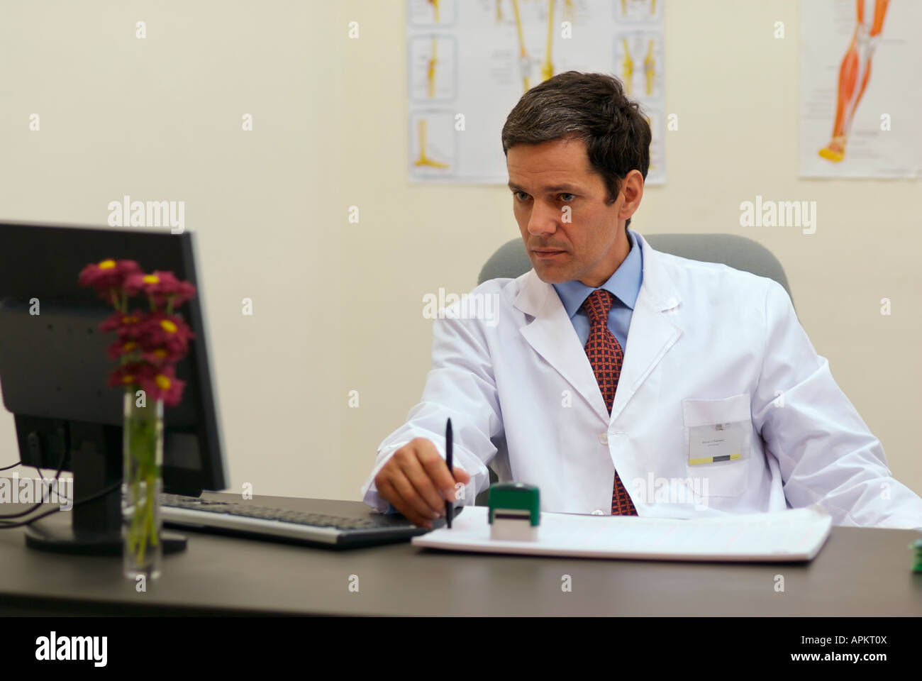 Doctor in an office Stock Photo