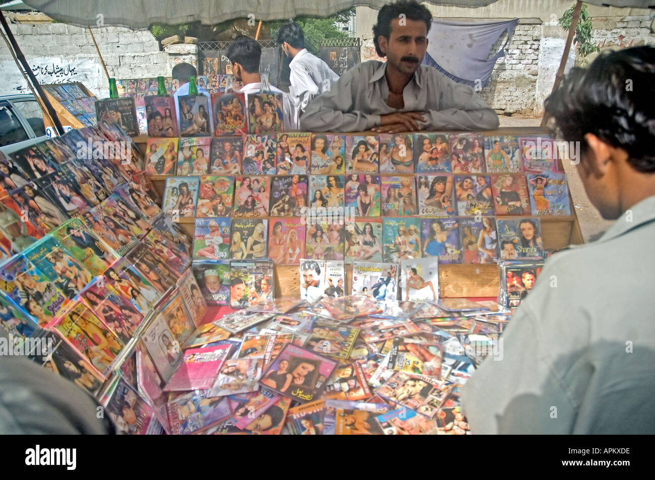 Pakistani Men Shopping For Soft Porn Pornography Vcds And Dvds Video In The Streets