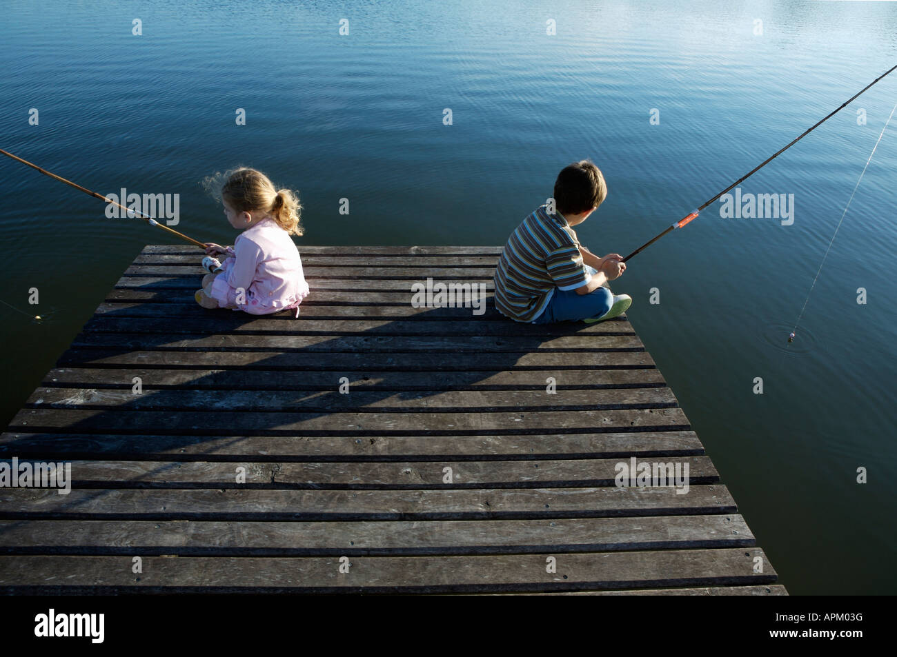Brothers fishing - Stock Image