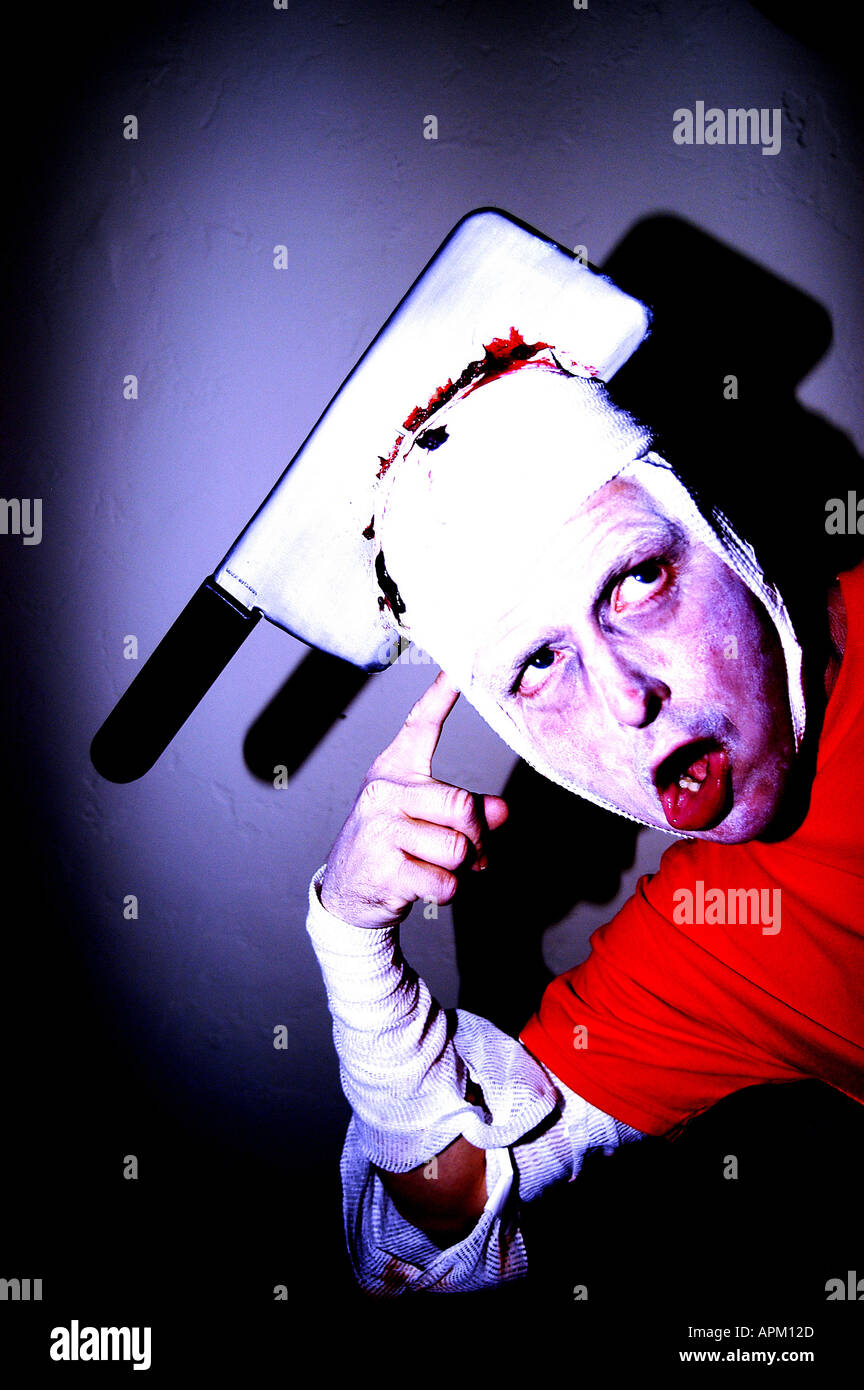 zombie with axe in his head - Stock Image