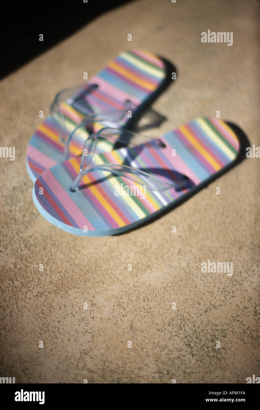 a pair of multi coloured pastel flip flops - Stock Image