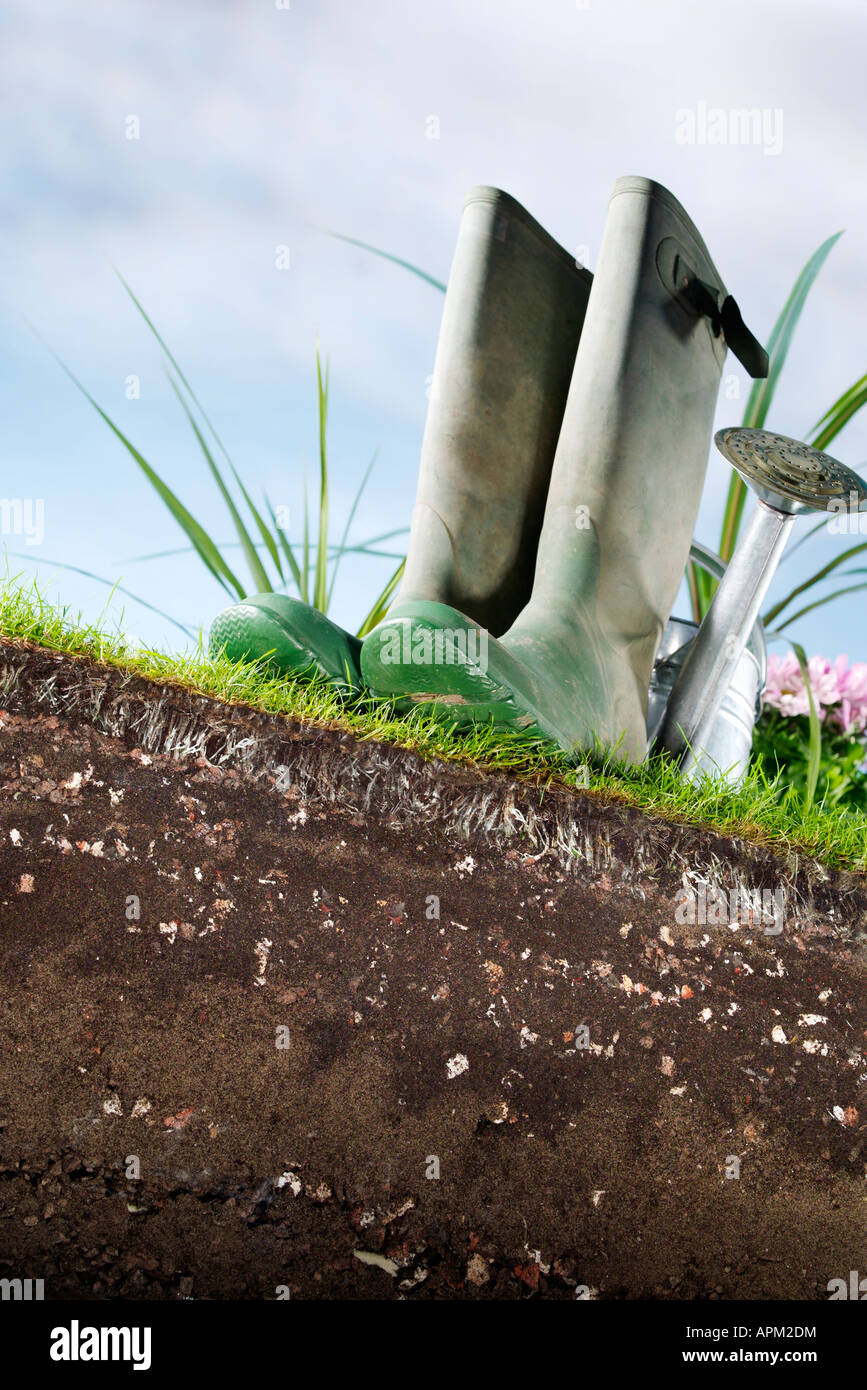 Wellies and soil - Stock Image