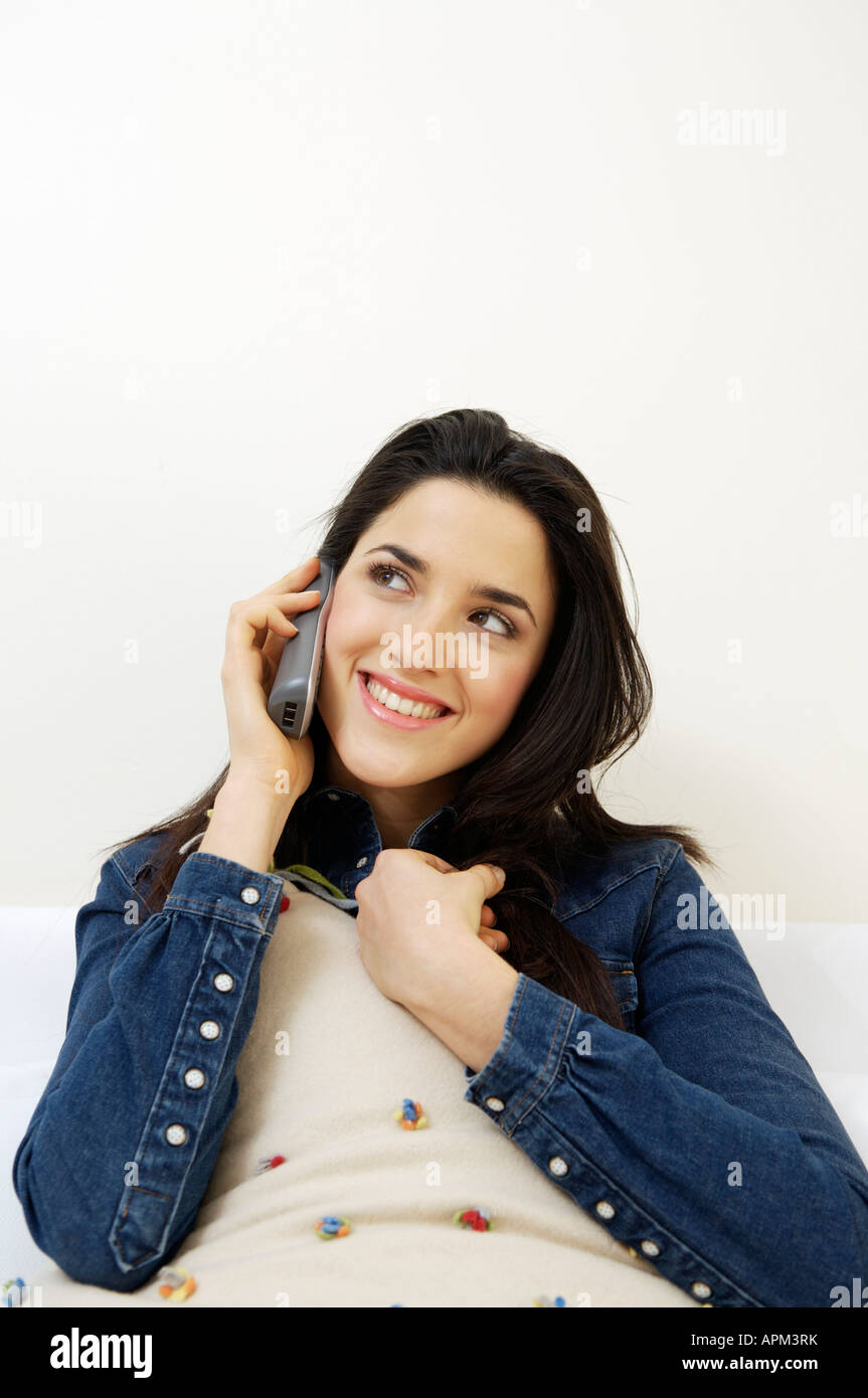 Young Woman talking on the phone Stock Photo