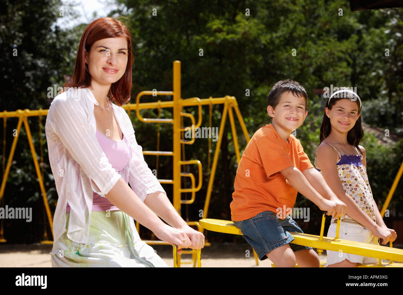 Mother and children in playground Stock Photo