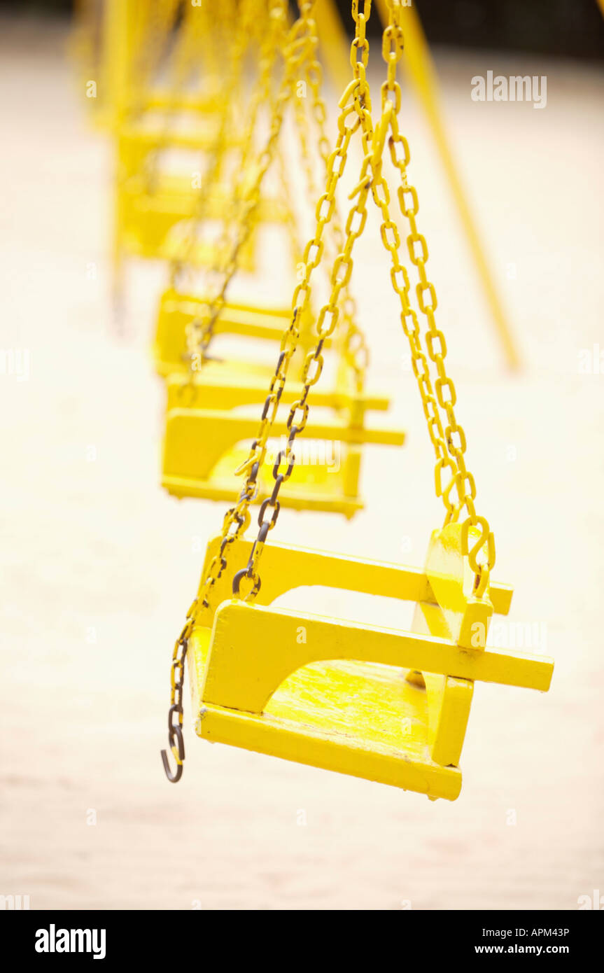 Swings at playground - Stock Image