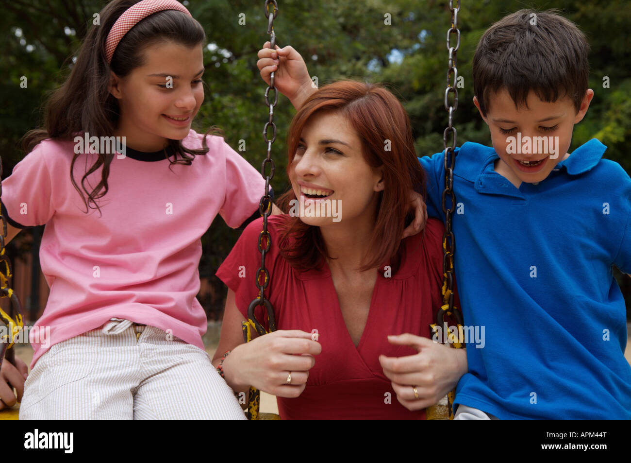 Mother and children in playground - Stock Image