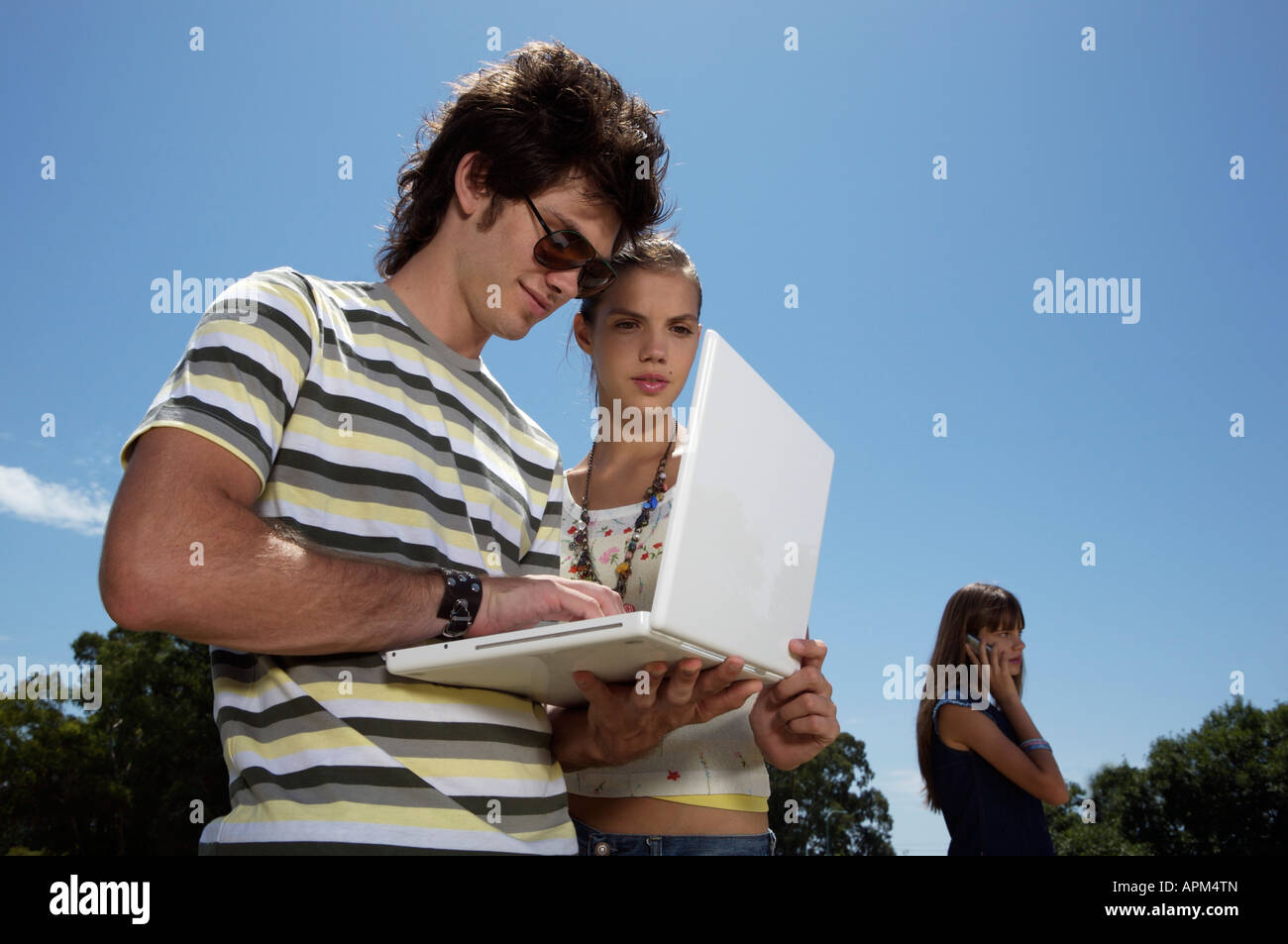 Three teenagers with notebook Stock Photo