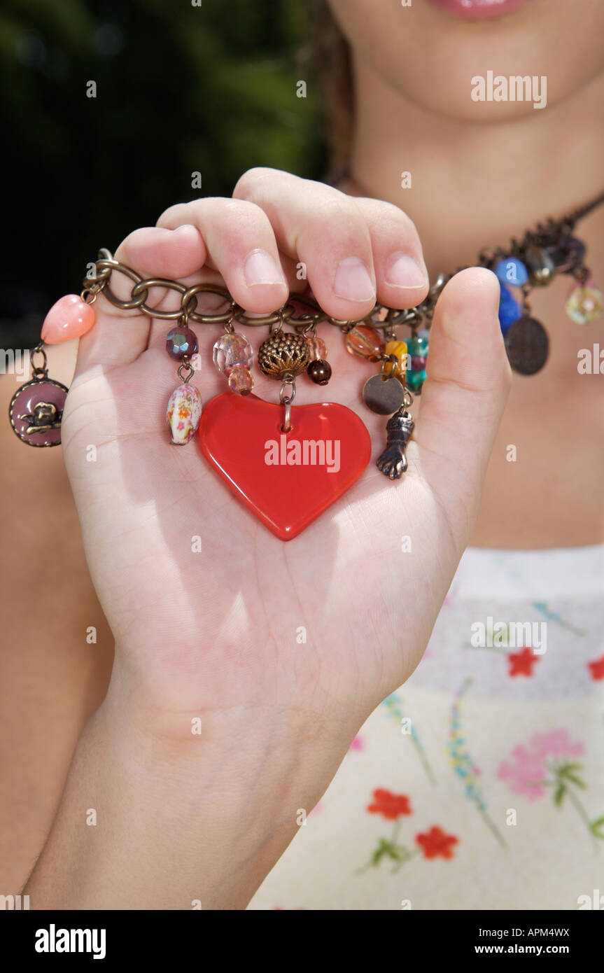 Teenage girl holding a necklace Stock Photo