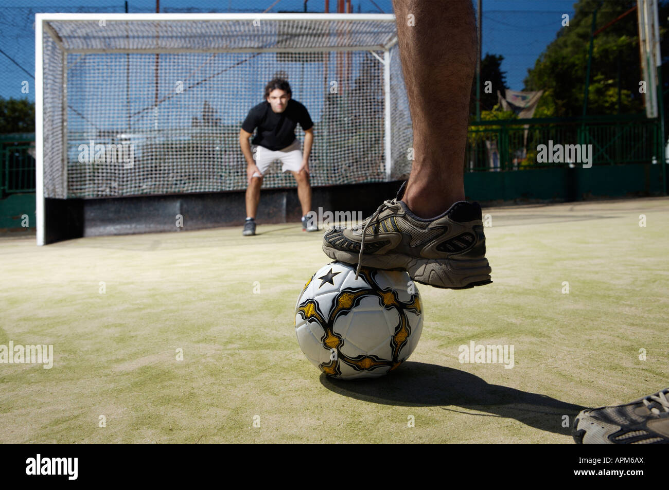 Friends playing football - Stock Image