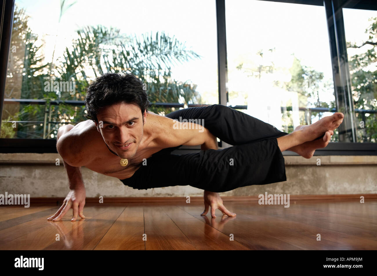 Man practicing yoga - Stock Image