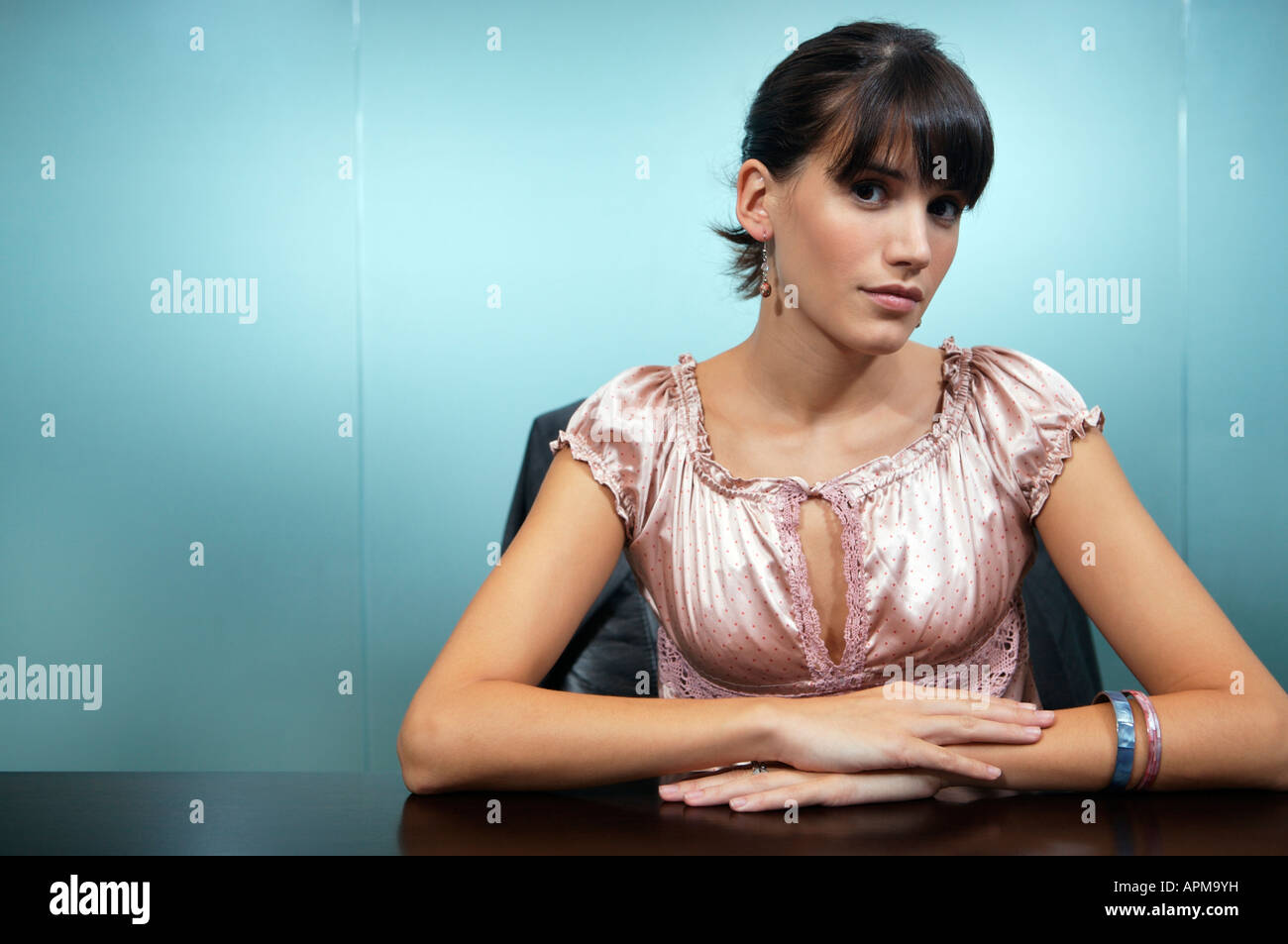 Business woman in her office - Stock Image