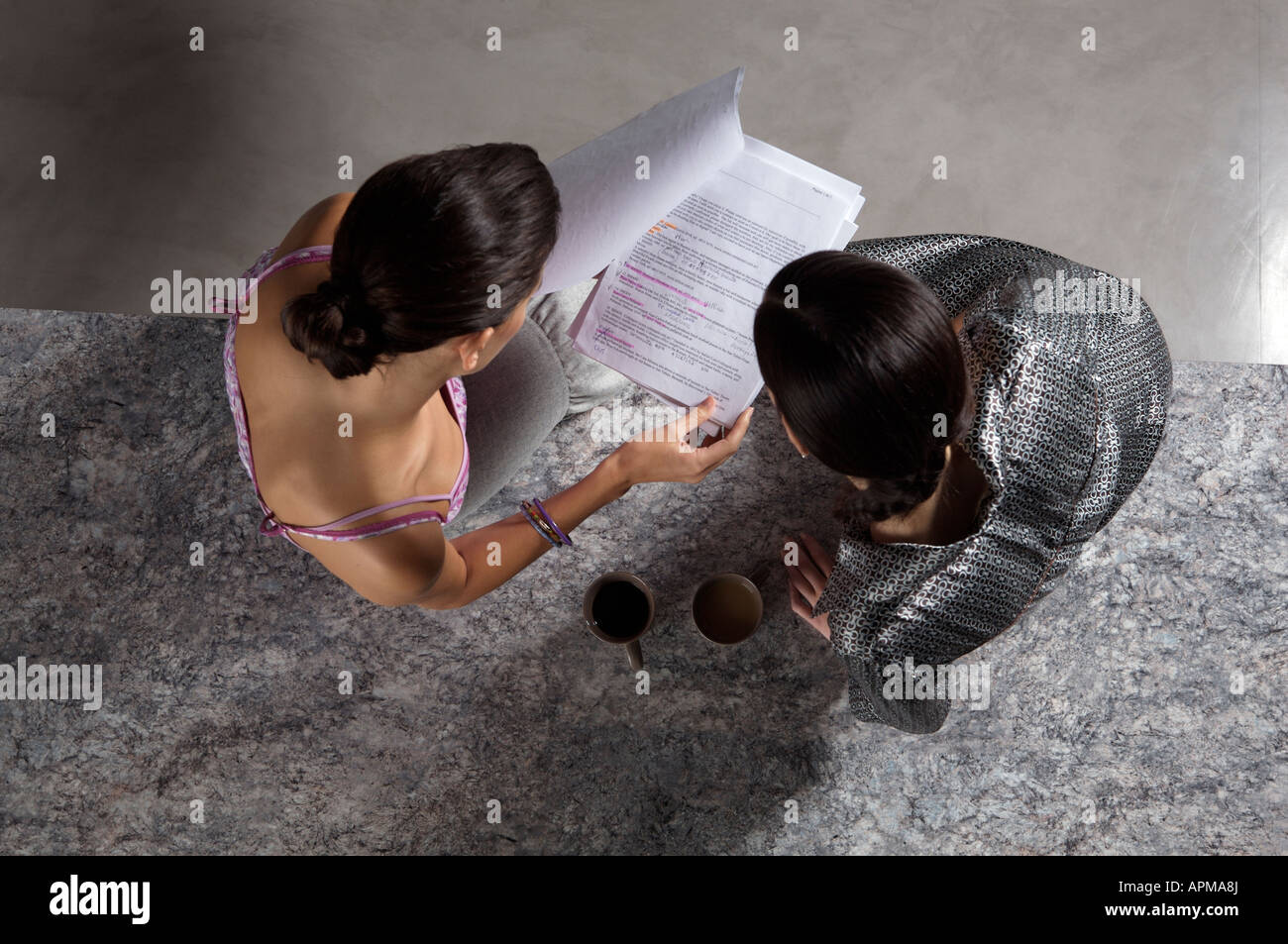 Two business women reading paperwork Stock Photo