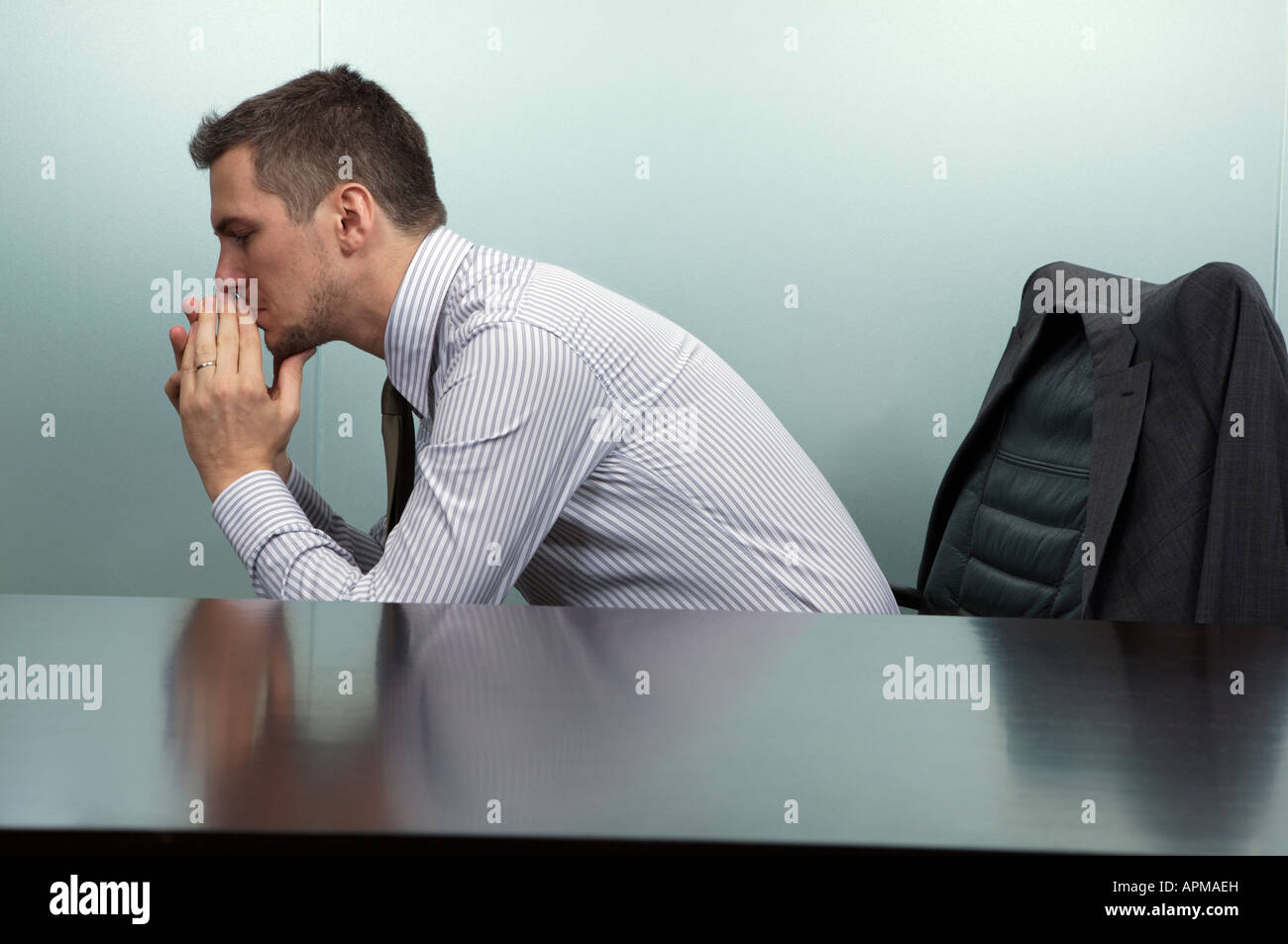 Upset man in his office - Stock Image