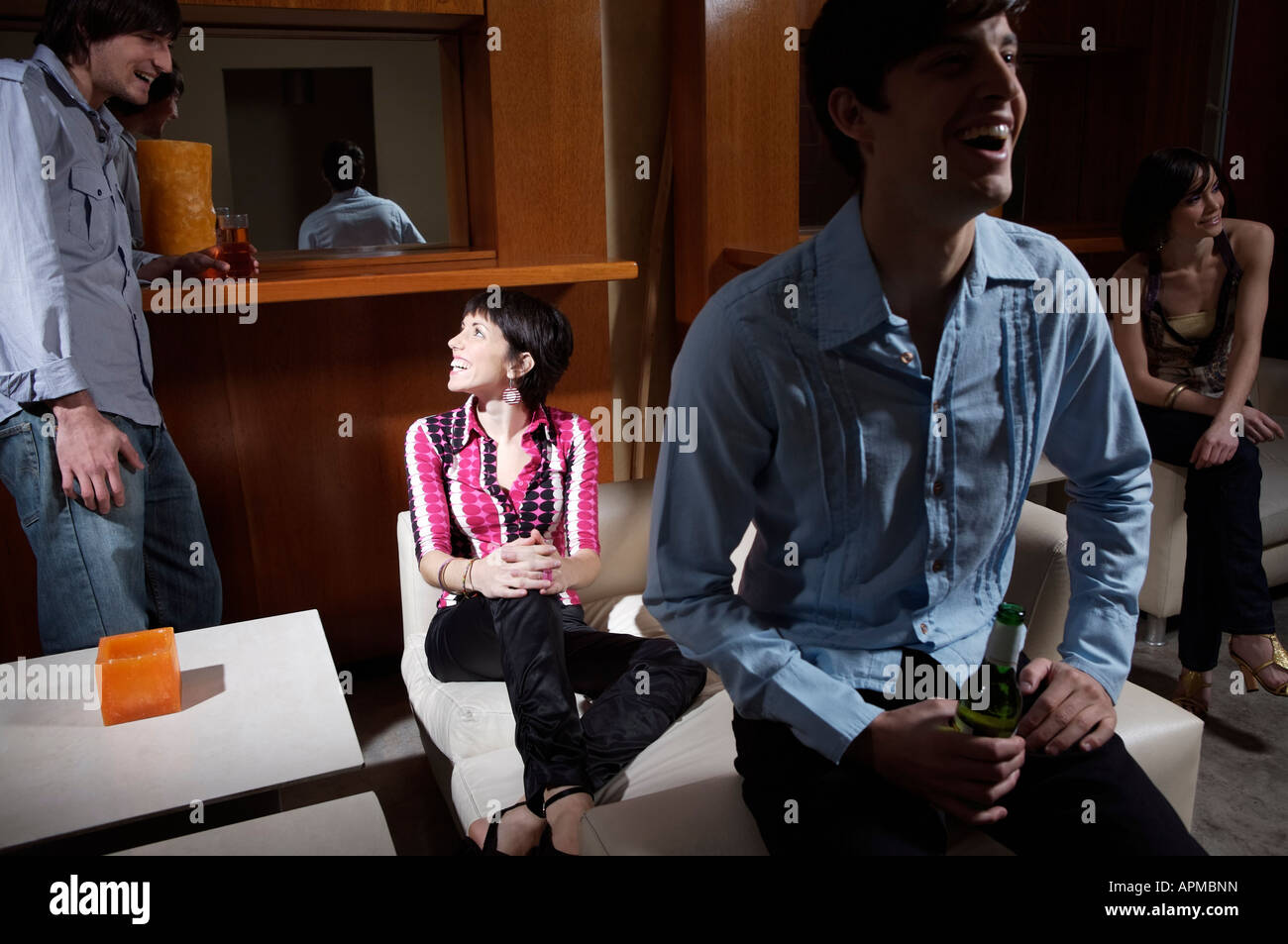 Group of people in a bar - Stock Image