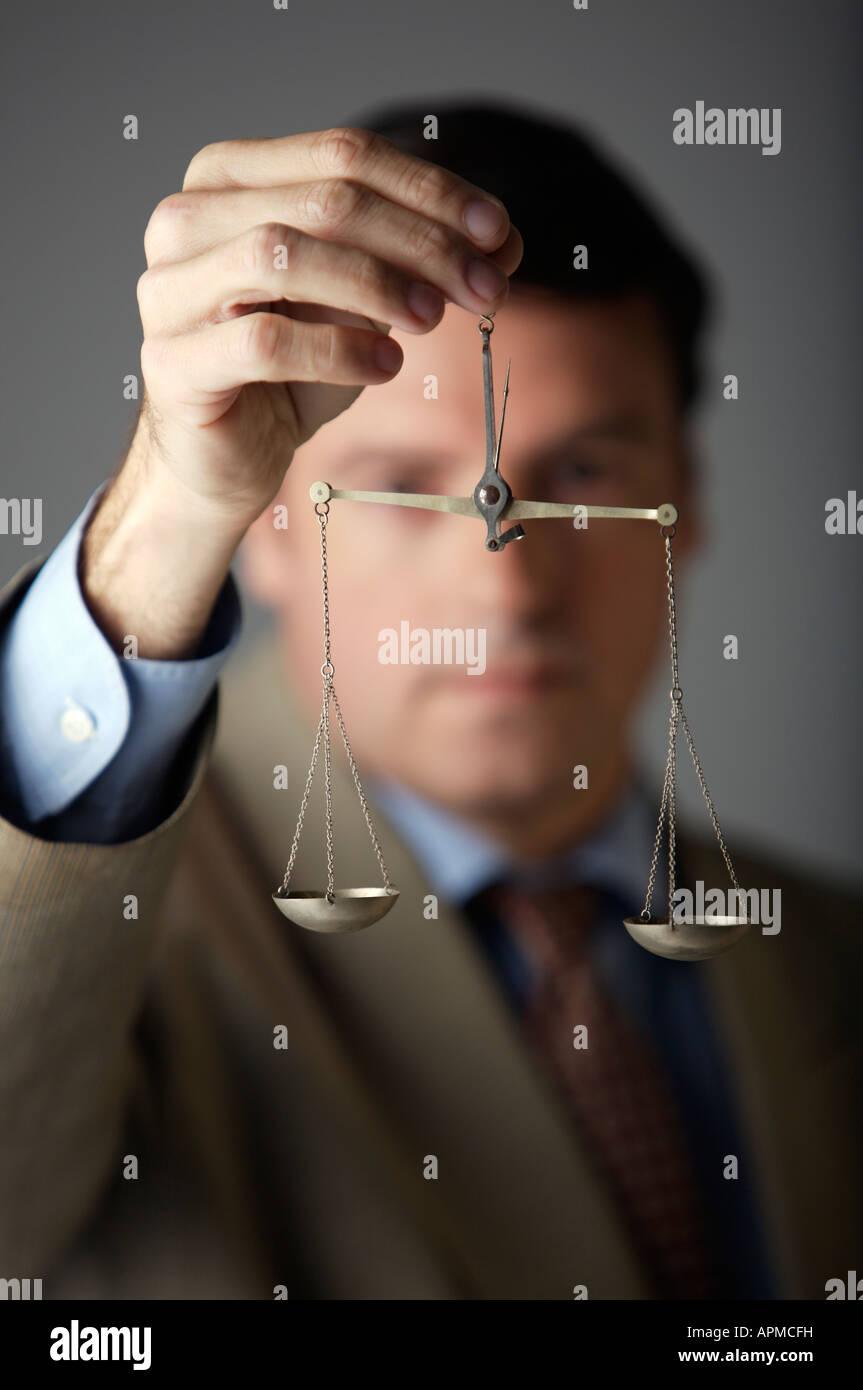 Man holding a balance - Stock Image